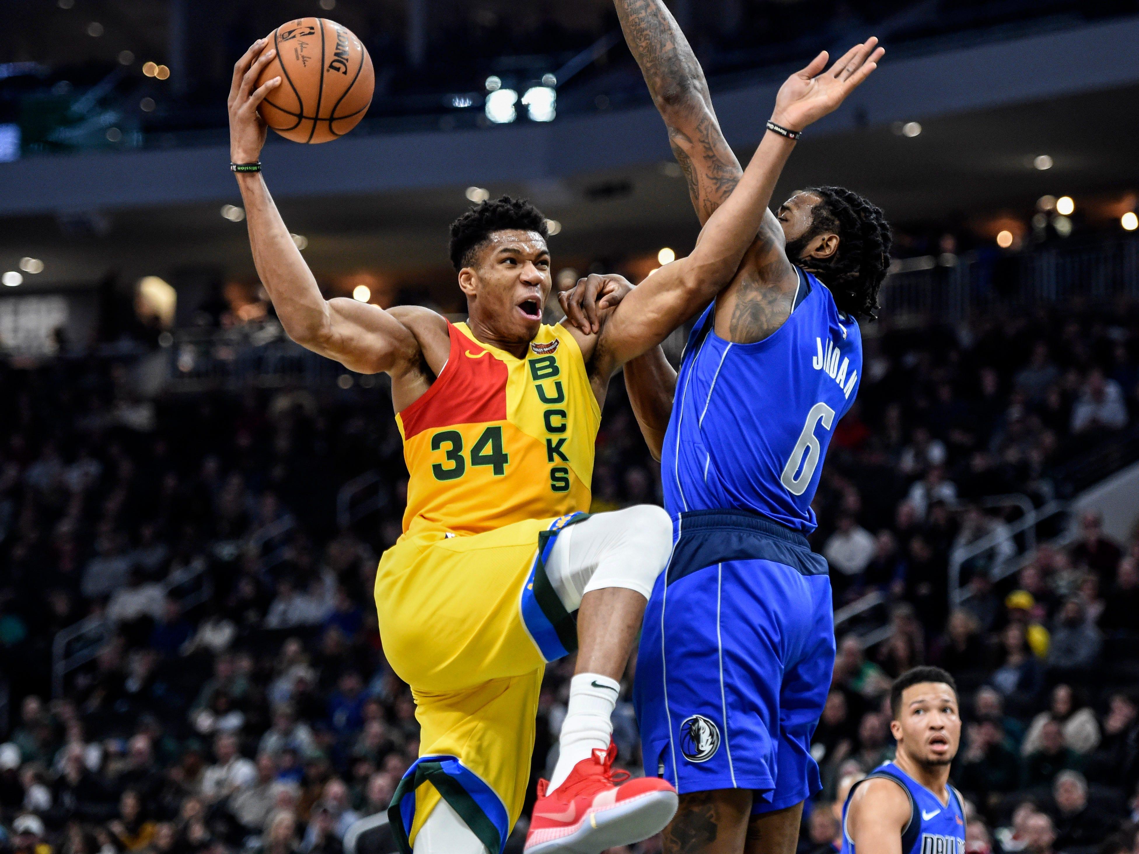 Jan. 21: Bucks forward Giannis Antetokounmpo drives to the hoop against Mavericks center DeAndre Jordan during the first half at the Fiserv Forum in Milwaukee.