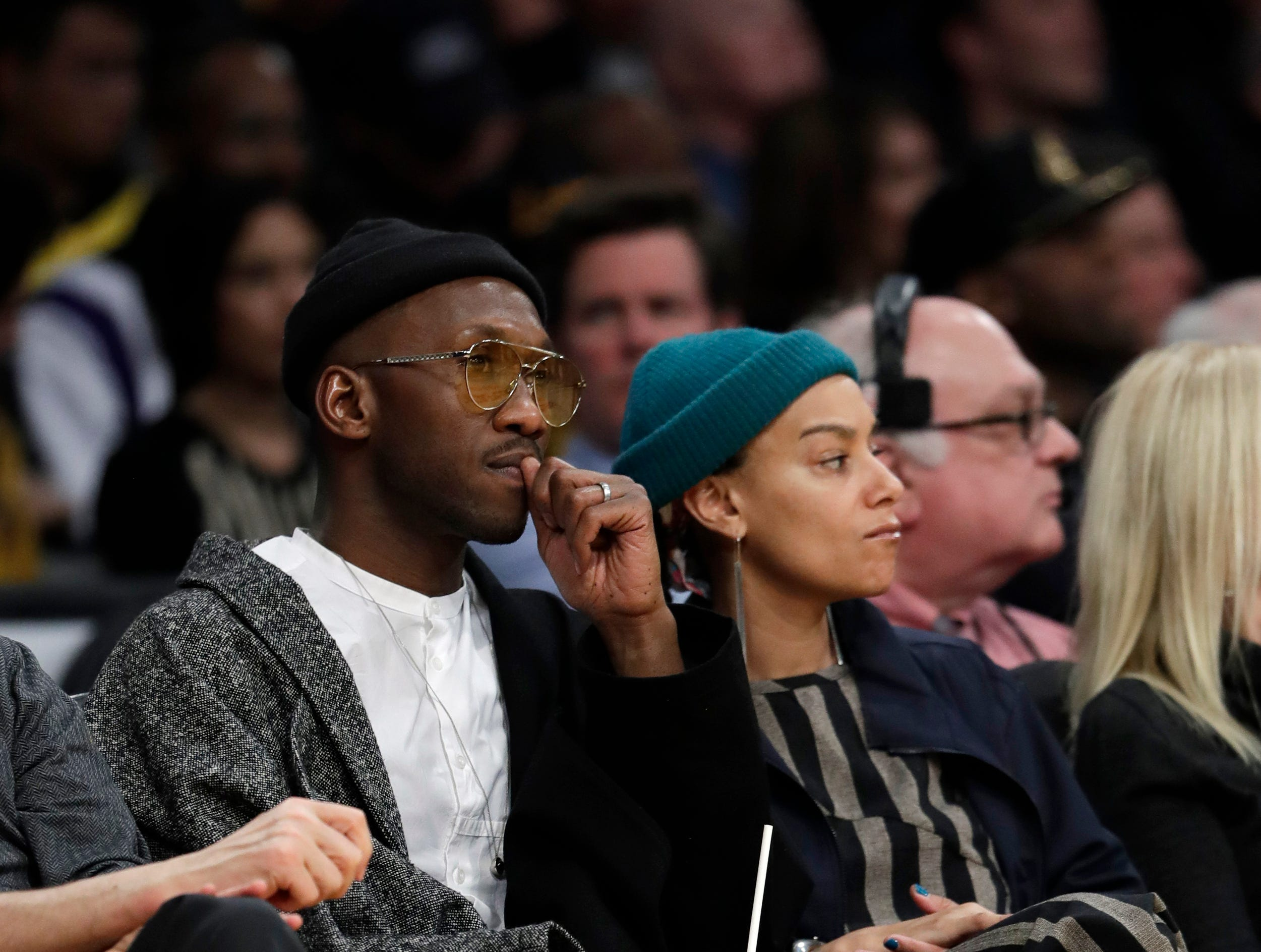 Actor Mahershala Ali, left, watches an NBA basketball game between the Los Angeles Lakers and the Golden State Warriors, Monday, Jan. 21, 2019, in Los Angeles. (AP Photo/Marcio Jose Sanchez) ORG XMIT: LAS110