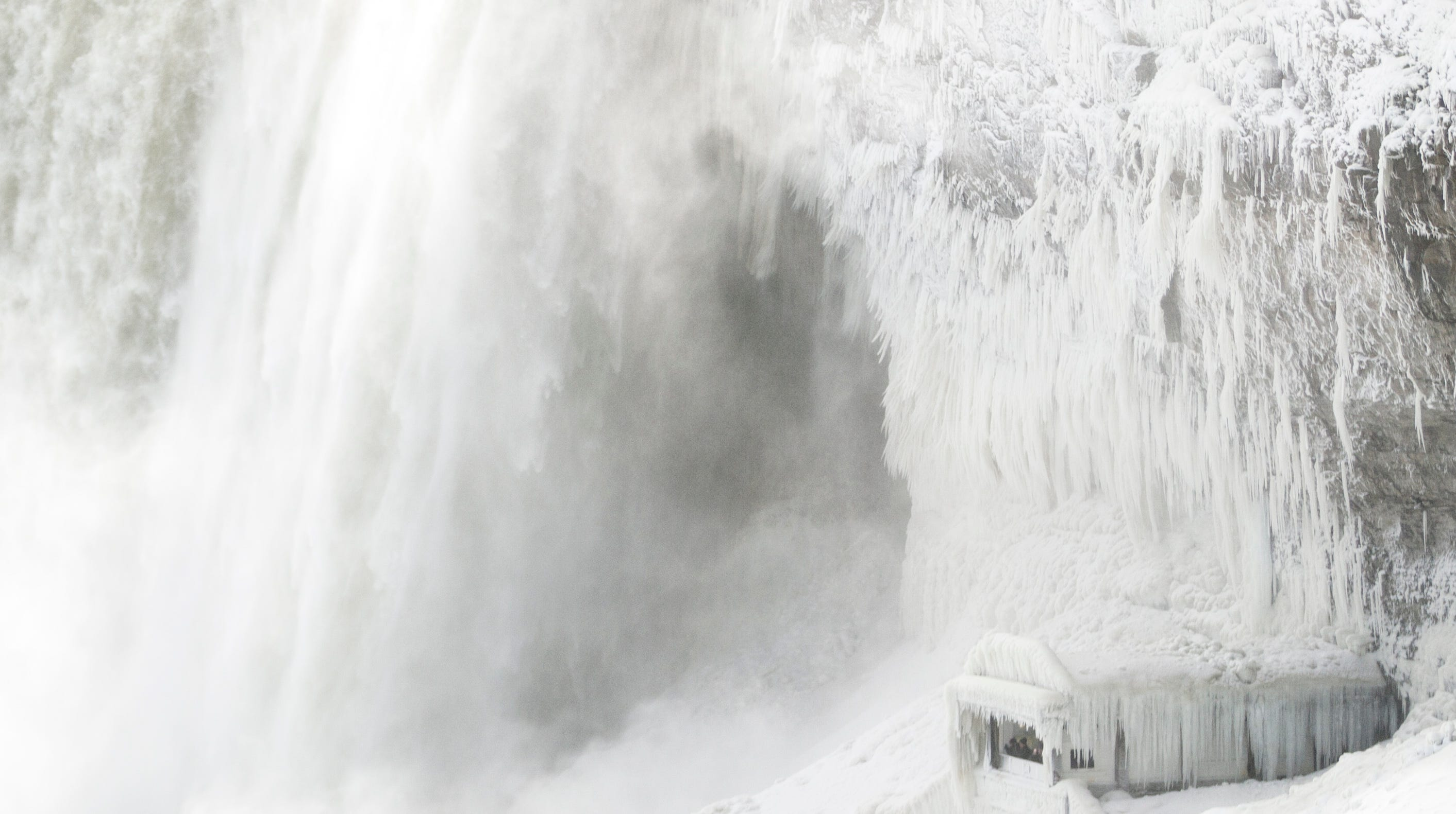Ice coats the rocks and observation deck at the base of the Horseshoe falls in Niagara Falls, Ontario on January 3, 2018.