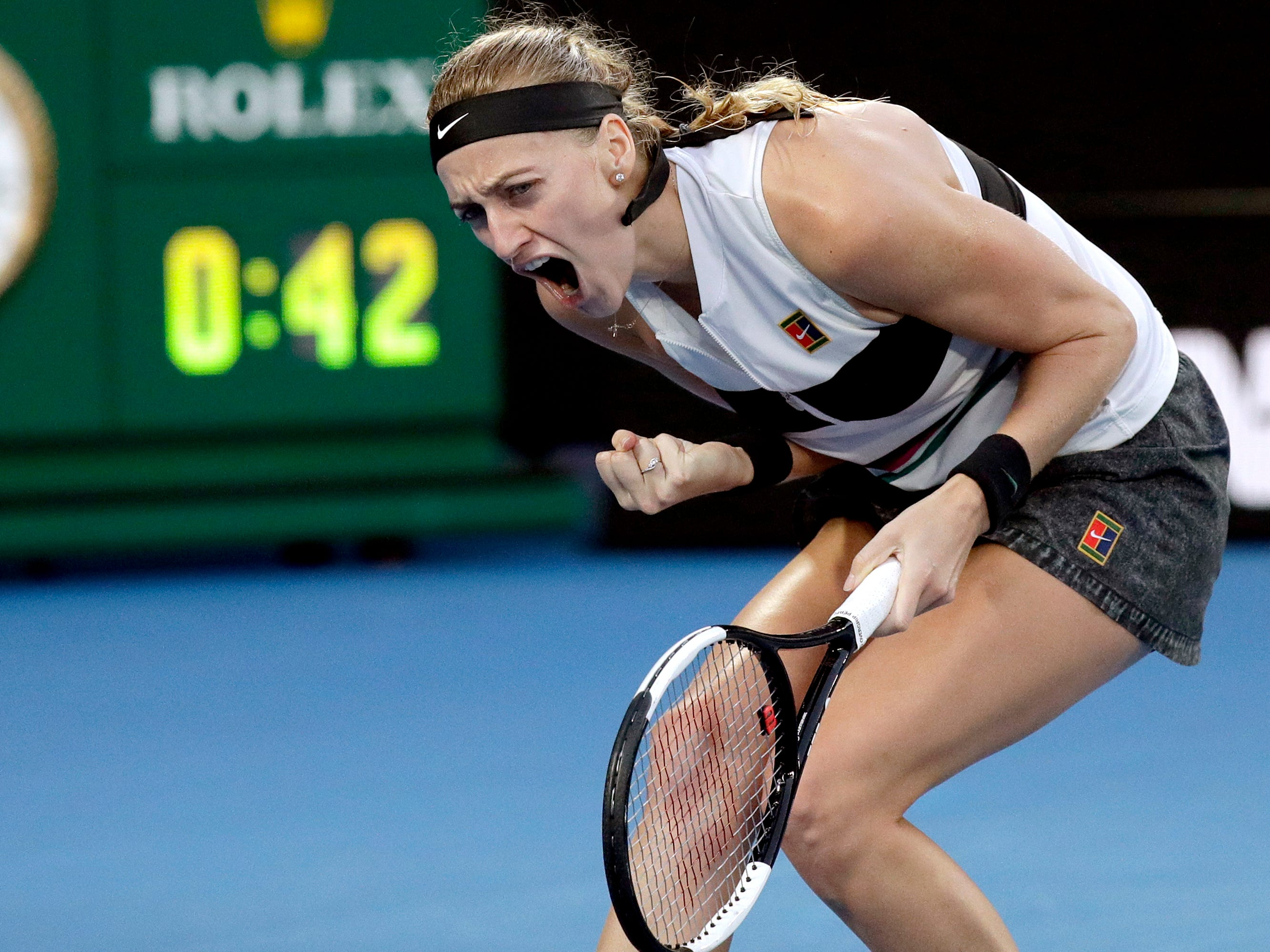Petra Kvitova of the Czech Republic reacts after winning a point against Australia's Ashleigh Barty.