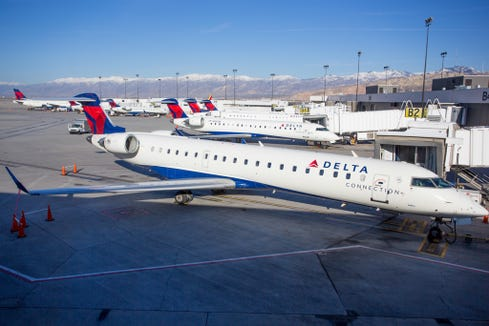 Multiple Delta Connection Bombardier CRJ regional are seen in  Salt Lake City in November 2016.