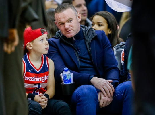 Wayne Rooney is enjoying living in relative anonymity in the Washington D.C. area, where he can take one of his sons to an NBA game without being mobbed.