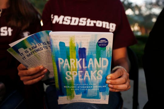 "Leni Steinhardt, 16, reads from a new book called ""Parkland Speaks: Survivors from Marjory Stoneman Douglas Share Their Stories"" on Jan. 16, 2019."