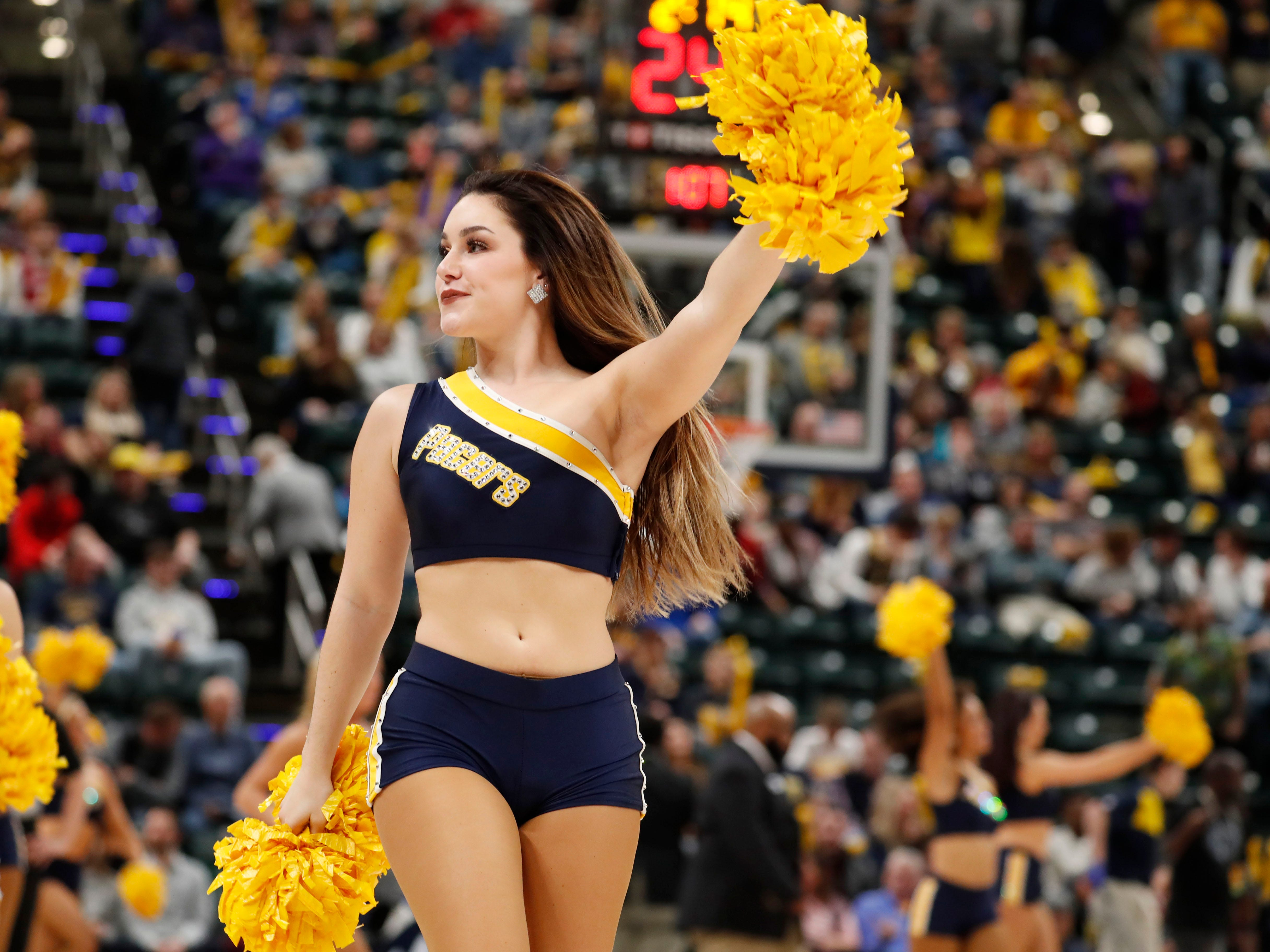 Jan. 20: A Pacers dancer performs a routine during a game against the Hornets.