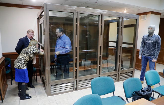 Paul Whelan stands inside a glass and metal cage in Moscow on Jan. 22. during a hearing of an appeal on his arrest.
