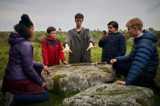 """Young Merlin (Angus Imrie, center) teaches a bunch of young Brits (Rhianna Dorris, Louis Ashbourne Serkis, Dean Chaumoo and Tom Taylor) about being knights in """"The Kid Who Would Be King."""""""
