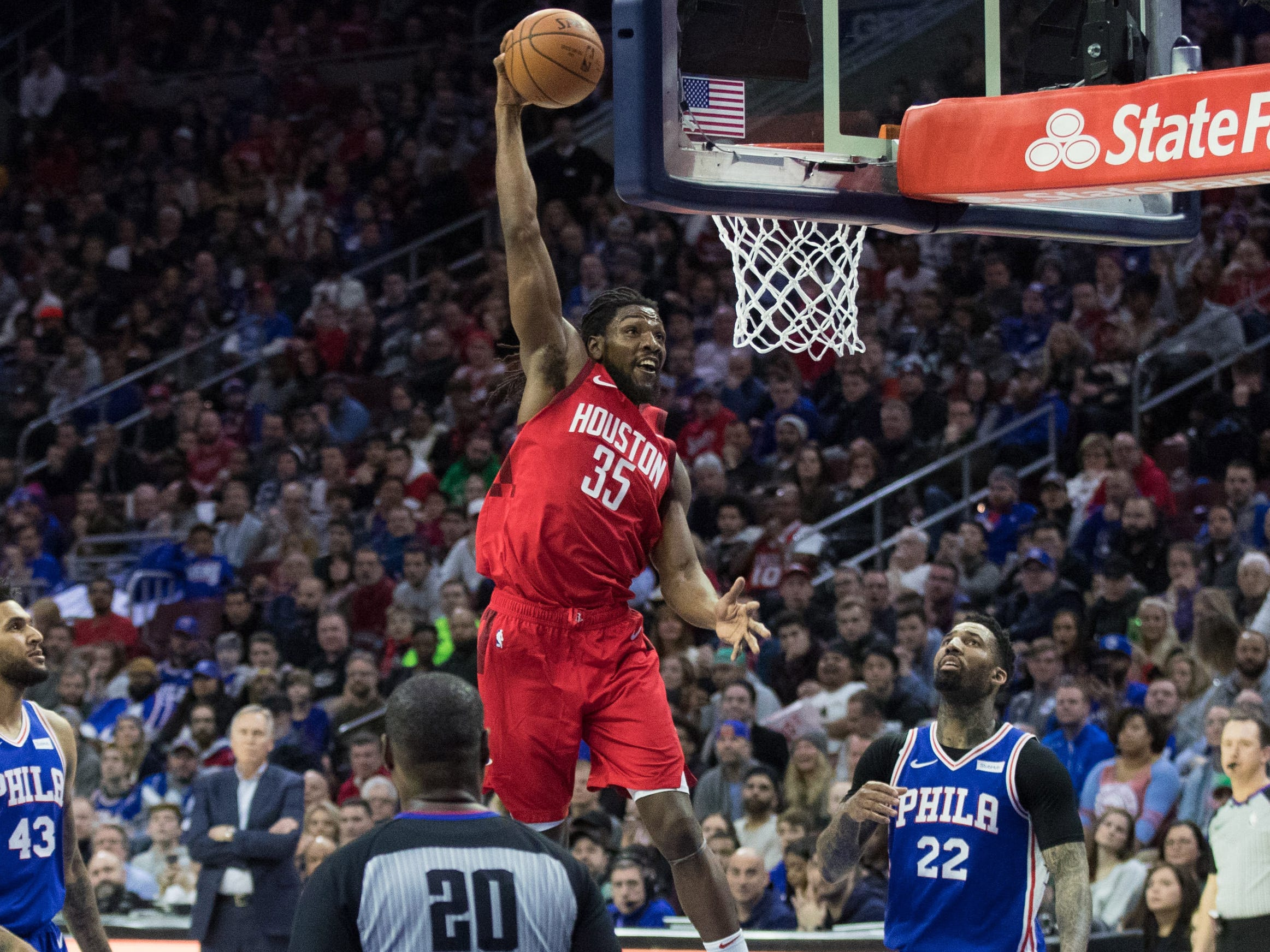 Jan. 21: Newly-signed Rockets forward Kenneth Faried soars to the bucket for a thunderous one-handed slam against the 76ers.