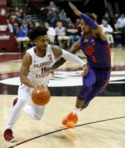 Florida State guard David Nichols (11) drives against Clemson Tigers guard Marcquise Reed (2) during the first half at Donald L. Tucker Center Tuesday night in Tallahassee, Fla.