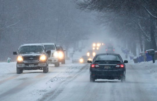 Traffic moves slowly along Capitol Drive during a snowstorm Wednesday, January 23, 2019, in Appleton, Wis.