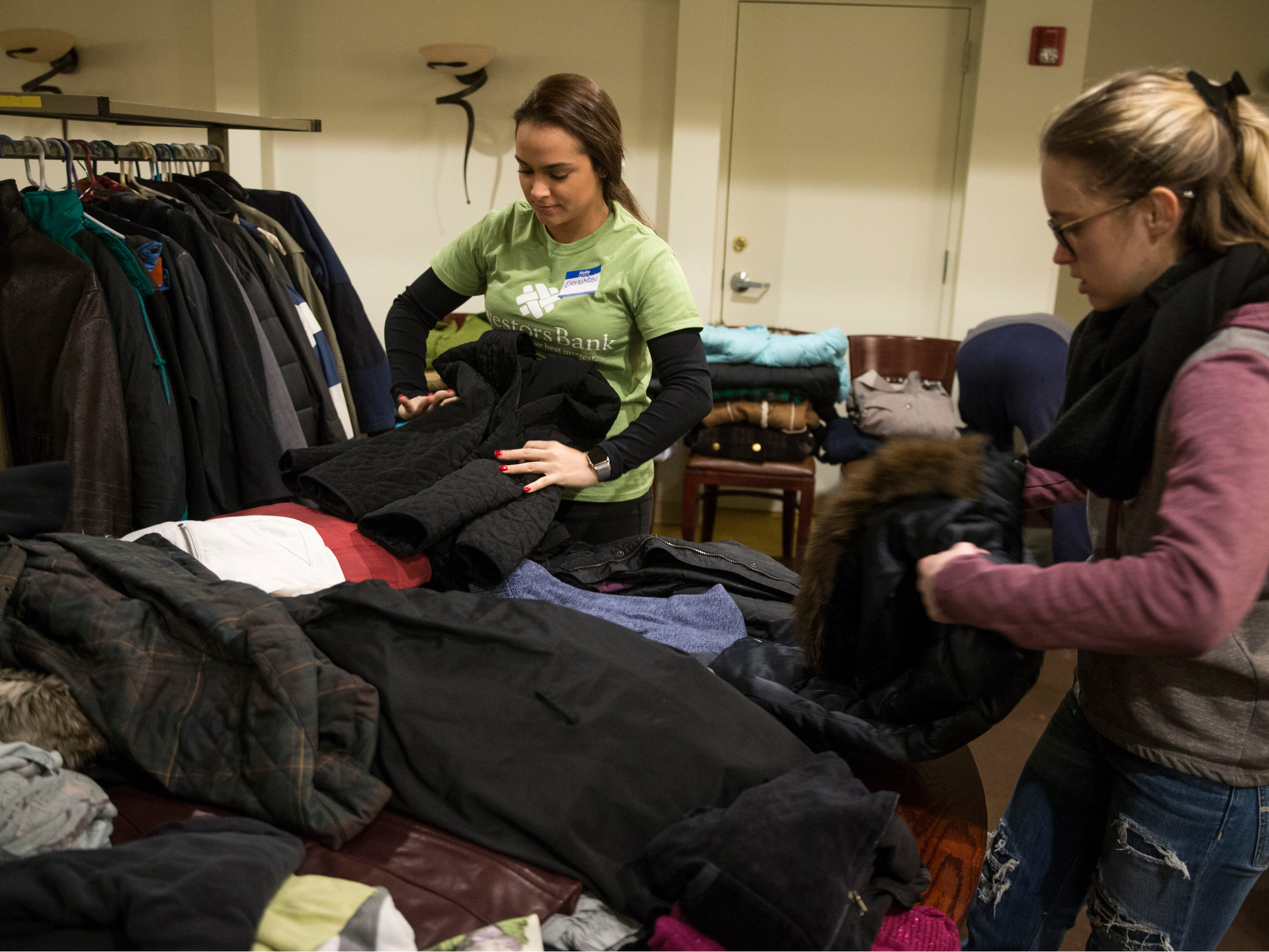 Volunteers ElenaRose Villali and Katie Cikovski sort through coats to be distributed to those in need. New Jersey housing advocates conduct the state's annual NJCounts, a point-in-time count of homelessness.       Freehold, NJWednesday, January 23, 2019