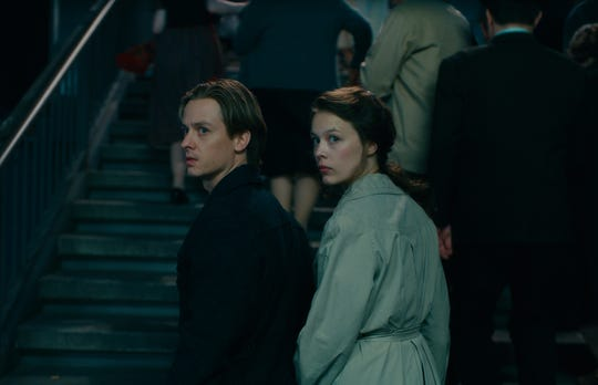 "Tom Schilling as Kurt Barnert, Paula Beer as Ellie Seeband in ""Never Look Away."""