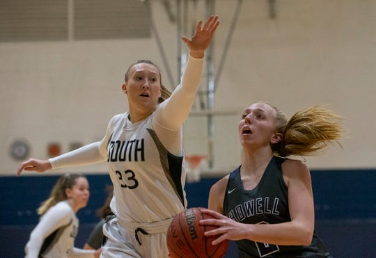 Middletown South's Eve Pirie tries to block a shot by Howell's Catilyn Gresko during first half action. Howell Girls basketball vs Middletown South in Middletown, NJ on January 22, 2019.