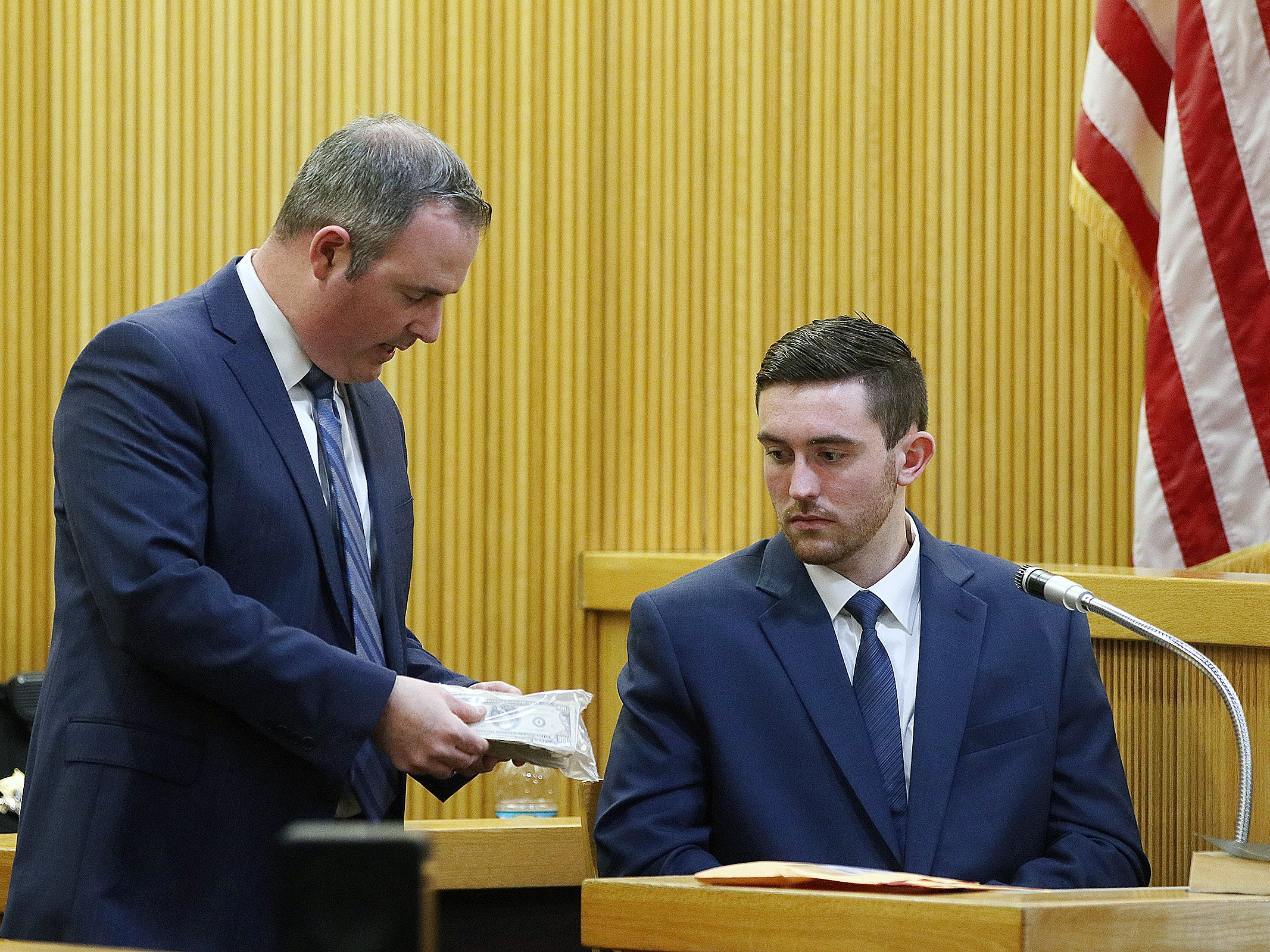 Chris Decker, Monmouth County assistant prosecutor, asks Preston Taylor, who plead guilty to charges in the Sarah Stern case, to identify evidence, which is cash that belonged to Sarah Stern, as he testifies during the trial of Liam McAtasney, who is charged with the murder of former high school classmate, Sarah Stern, before Superior Court Judge Richard W. English at the Monmouth County Courthouse in Freehold, NJ Wednesday January 23, 2019.