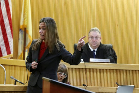 Meghan Doyle, Monmouth County assistant prosecutor, addresses the jury during opening statements as Liam McAtasney, who is charged with the murder of former high school classmate, Sarah Stern, appears for the first day of trial before Superior Court Judge Richard W. English at the Monmouth County Courthouse in Freehold, NJ Wednesday January 23, 2019.