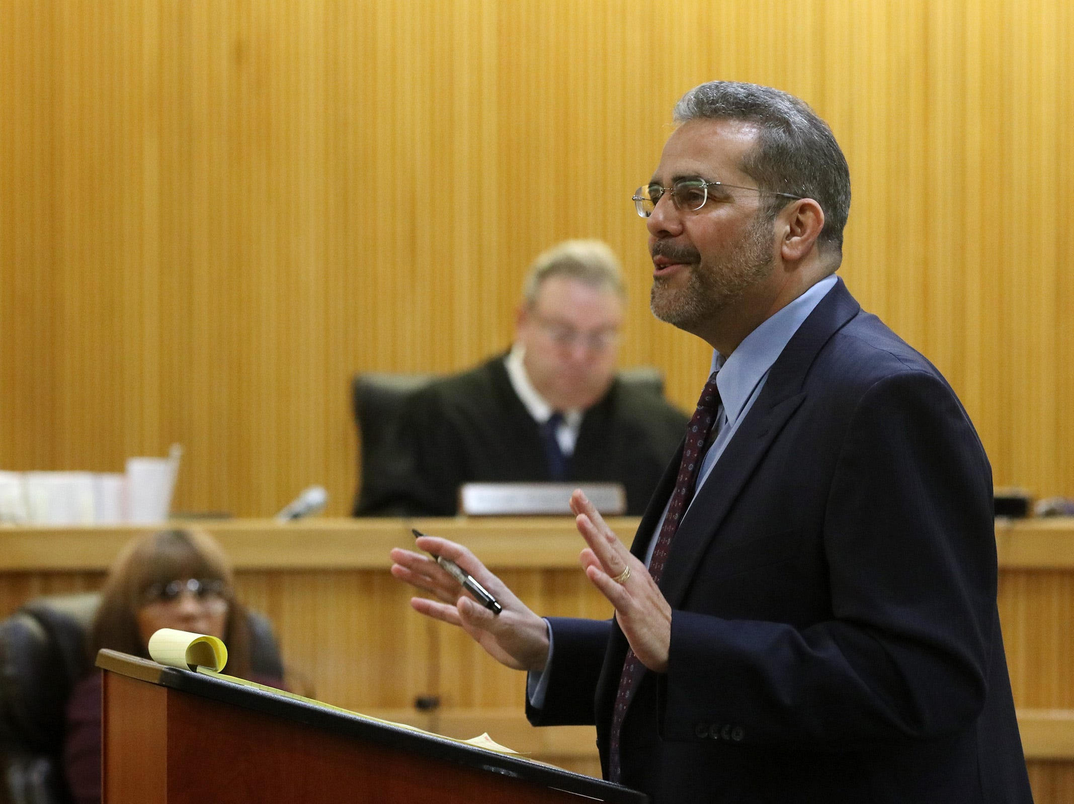 Carlos Diaz-Cobo, defense attorney, addresses the jury during opening statements as Liam McAtasney, who is charged with the murder of former high school classmate, Sarah Stern, appears for the first day of trial before Superior Court Judge Richard W. English at the Monmouth County Courthouse in Freehold, NJ Wednesday January 23, 2019.