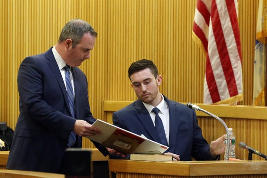 Chris Decker, Monmouth County assistant prosecutor, asks Preston Taylor, who plead guilty to charges in the Sarah Stern case, to identify evidence, which are walkie-talkies used by both Preston and Liam, as he testifies during the trial of Liam McAtasney, who is charged with the murder of former high school classmate, Sarah Stern, before Superior Court Judge Richard W. English at the Monmouth County Courthouse in Freehold, NJ Wednesday January 23, 2019.