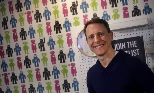 Chris Richardson, CEO of Talent Response, a website that helps small businesses find freelancers, poses in his Boston office.