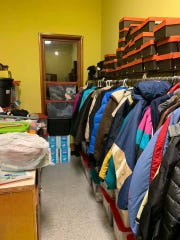 A stockroom of jackets and shoes at the the Riverwood Park recreation building that serves as a Code Blue warming center.