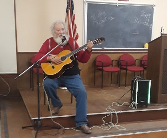 Stanley Prince, who sought refuge at Riverwood Park during Code Blue, entertains other guests.