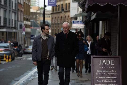 """Charlie Cox as Basil, left, and Michael Caine as Brian Reader in the thriller """"King of Thieves,"""" a Saban Films release."""