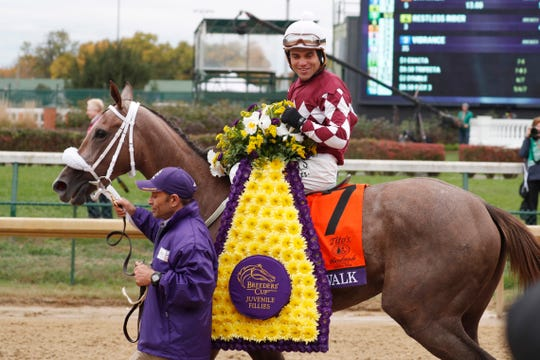 Joel Rosario aboard Jaywalk reacts after winning the Tito's Handmade Vodka Breeders' Cup Juvenile Fillies at Churchill Downs.
