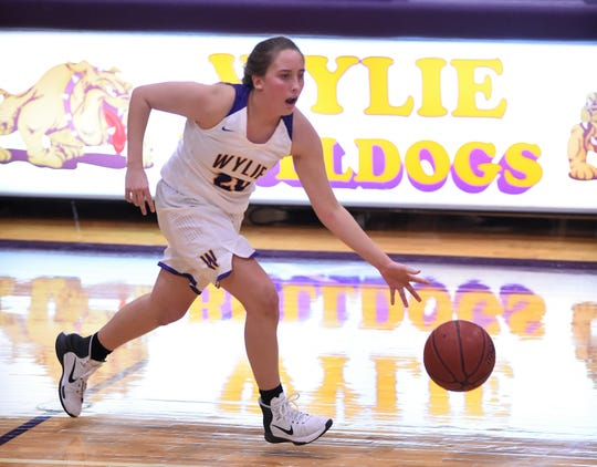 Sophomore guard Makinlee Bacon (20) was one of the four players Wylie moved onto the varsity roster before Tuesday's game. The Lady Bulldogs are trying to fill the void of injuries to Kamryn Dry and Emma Melton and plan for the future with eight seniors on the roster.
