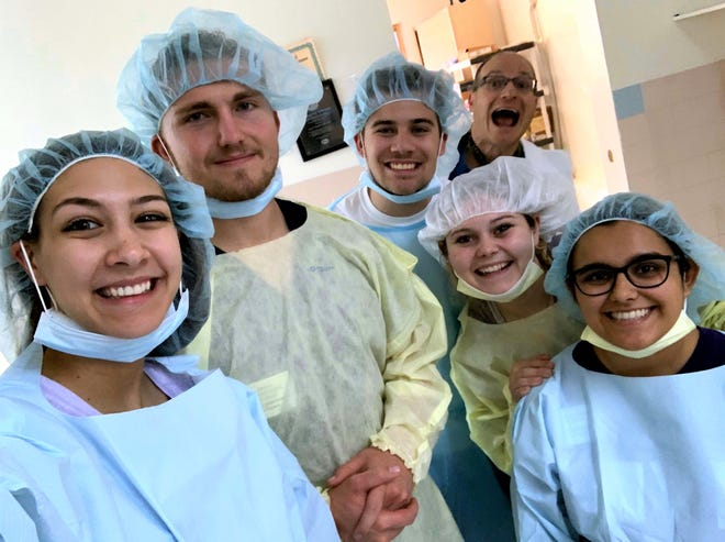 A group of Abilene Christian University students prepare to assist at a hospital in Haiti during their winter break mission trip