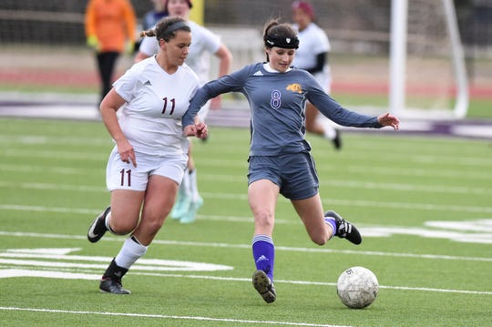 Wylie's Logan Bourland (8) passes the ball against Brownwood at Bulldog Stadium on Tuesday, Jan. 22, 2019. The Lady Lions won 3-1.