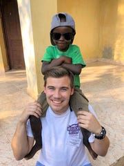 Aleksander Cook, an Abilene Christian University pre-med student, takes time out to have fun with a young boy at a hospital in Haiti.