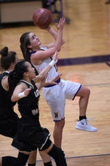 Wylie's Madi Latham (11) goes up to lay the ball in against Wichita Falls Rider at Bulldog Gym on Tuesday, Jan. 22, 2019. The Lady Bulldogs won 69-30.