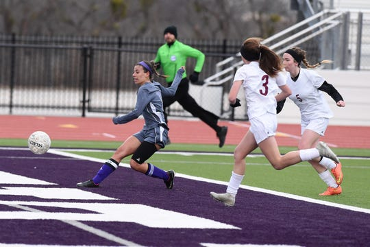 Wylie's Leandra Benton (19) shoots and scores against Brownwood at Bulldog Stadium on Tuesday, Jan. 22, 2019. The Lady Lions won 3-1.