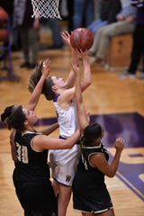 Wylie freshman Audrey Brewer (30) scored the first points of her varsity career on Tuesday night against Wichita Falls Rider. Brewer was one of several JV players called up by the Lady Bulldogs after losing a second player for the year due to injury.