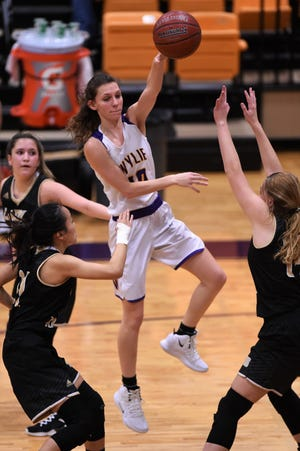 Wylie's Abbey Henson (10) passes the ball against Wichita Falls Rider at Bulldog Gym on Tuesday, Jan. 22, 2019. The Lady Bulldogs won 69-30.
