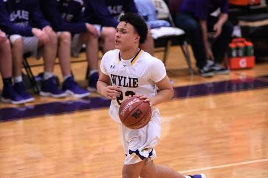 Wylie guard Shayden Payne (22) brings the ball down the court against Wichita Falls Rider at Bulldog Gym on Tuesday, Jan. 22, 2019. Rider won 58-42.