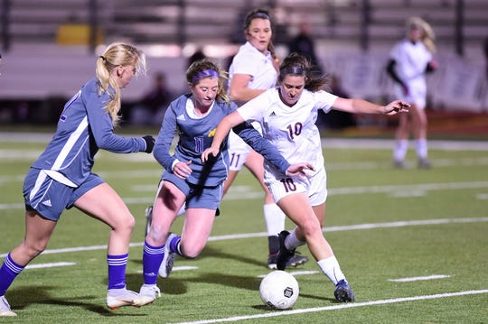 Wylie's Shaelyn Ward (11) battles Brownwood's Carly Person (10) for the ball at Bulldog Stadium on Tuesday, Jan. 22, 2019. The Lady Lions won 3-1.