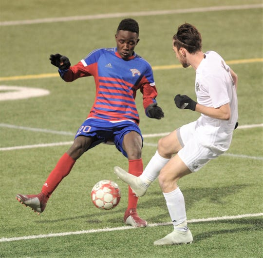 Cooper's Uwezo Innocent, left, battles an Odessa Permian player for the ball. The teams played to a 2-2 tie in the nondistrict game Tuesday, Jan. 22, 2019, at Shotwell Stadium.