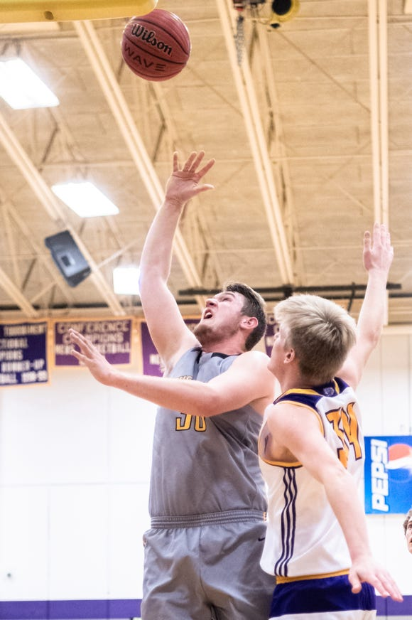 Tuscola's Landon Henley makes a basket, breaking the school's all-time scoring record of 1,681 during their game agaist North Henderson, Jan. 22, 2019. Tuscola won 75-55.