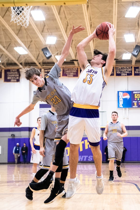 Tuscola's Nate Brafford attempts to block a shot by North Henderson's Gabe Murphy during their game Jan. 22, 2019. Tuscola won 75-55.