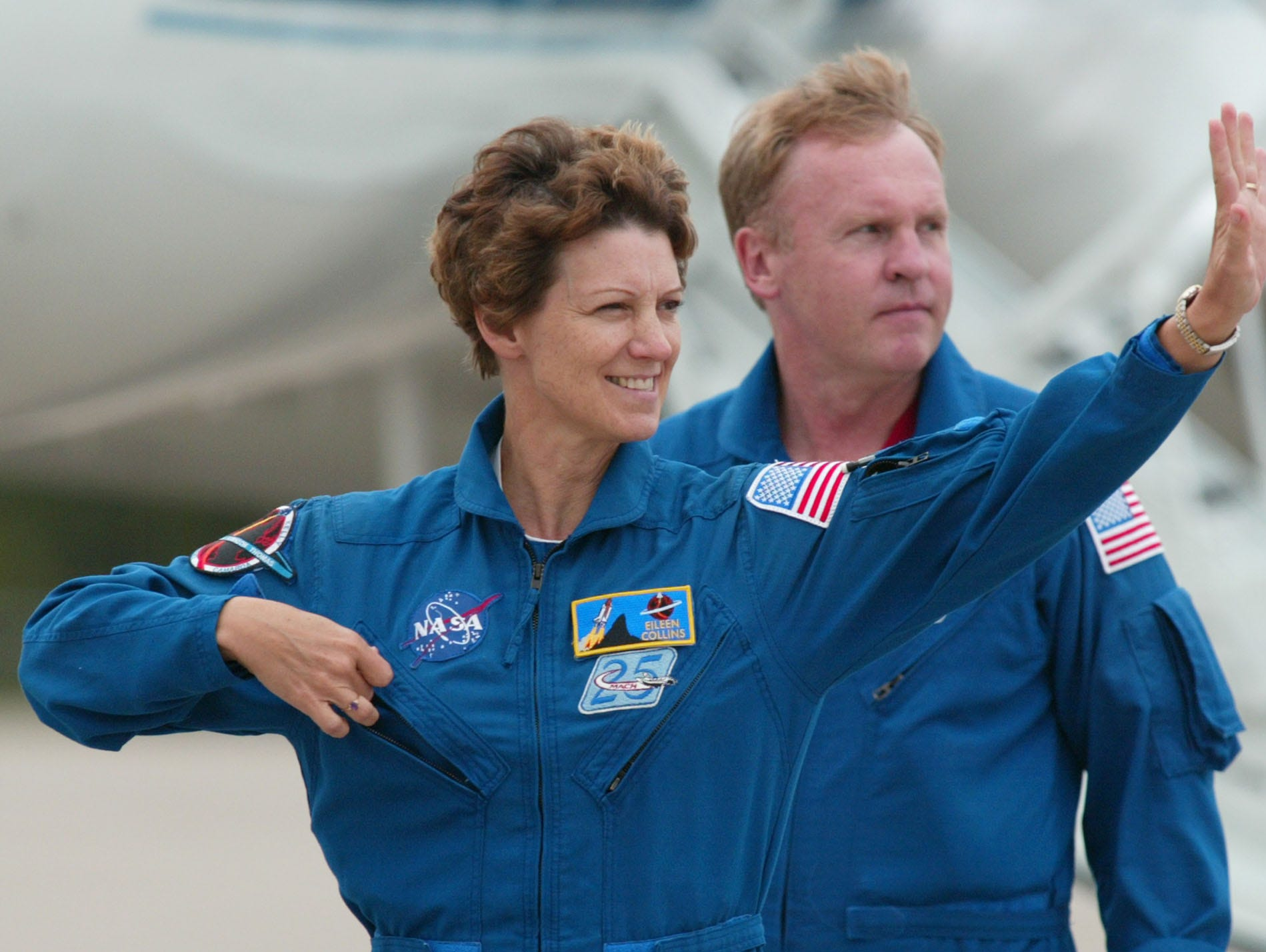 Space Shuttle Commander Eileen Collins, born in Elmira,  waves to the media as she arrives at the Kennedy Space Center with Austrailian born astronaut Andrew Thomas following her, Saturday, July 9, 2005 Cape Canaveral, Fla.