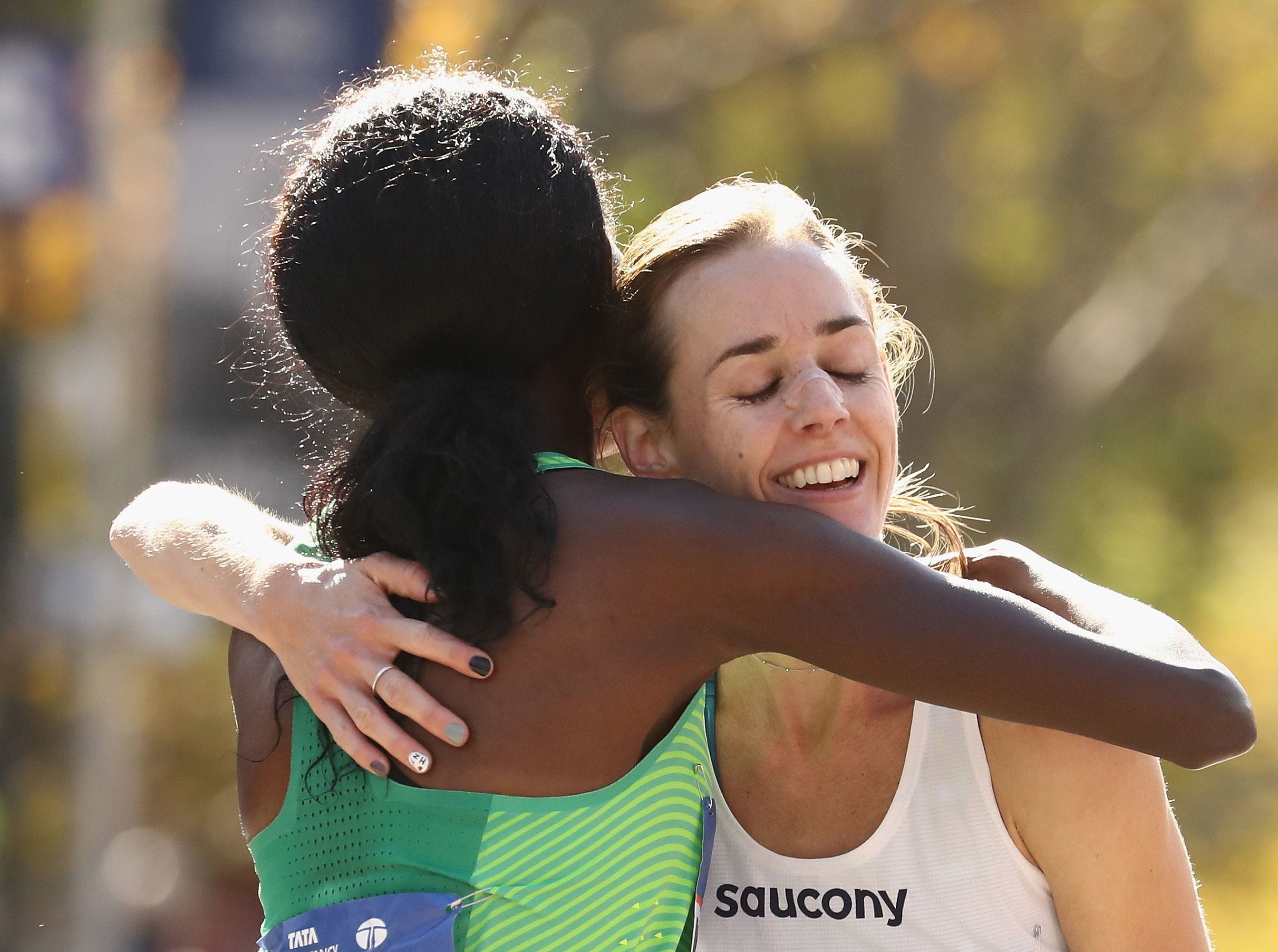 Sally Kipyego of Kenya and Molly Huddle embrace after 2016 New York City Marathon. Huddle is a native of Elmira, NY.