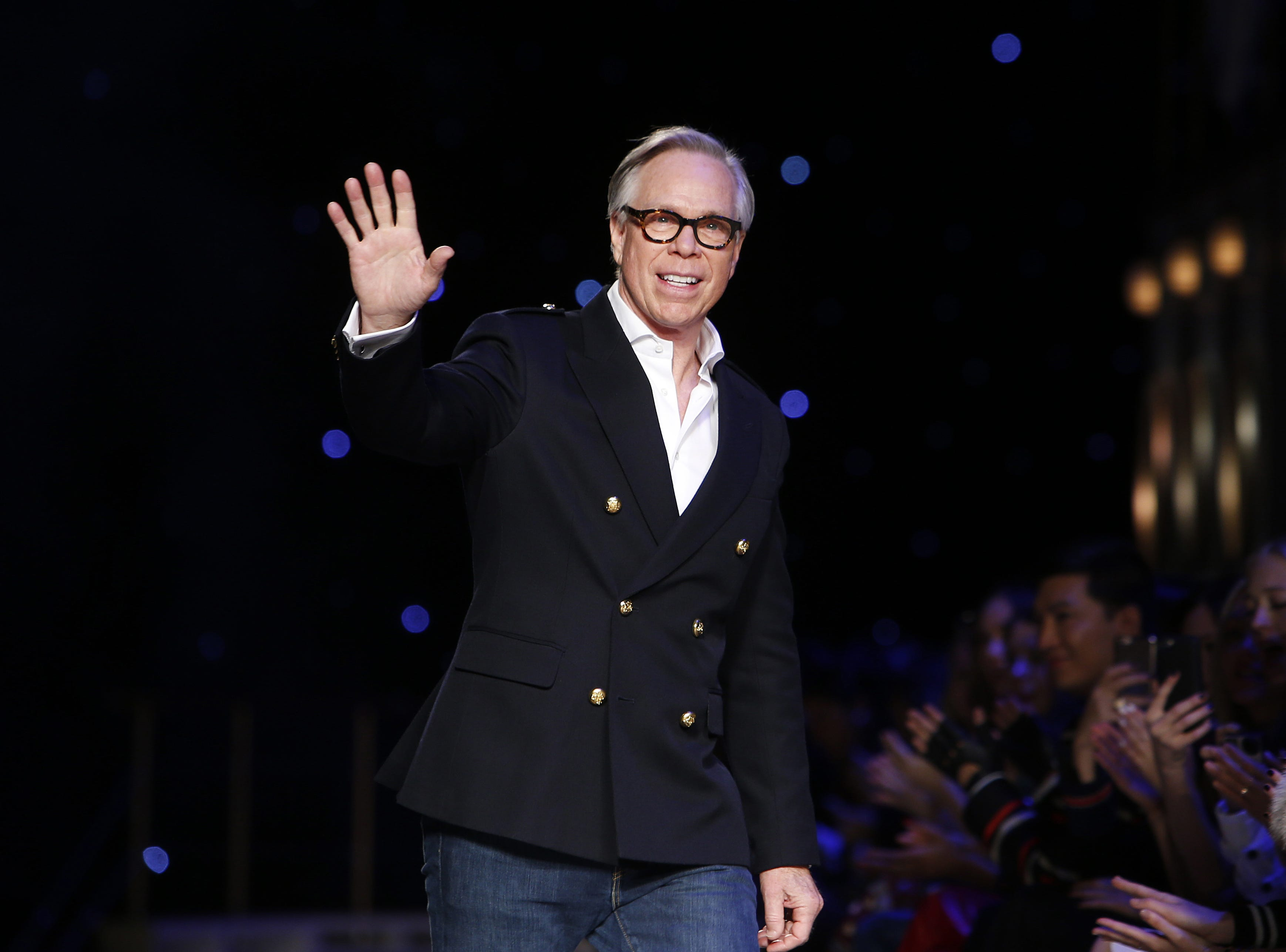 In a Monday, Feb. 15, 2016 file photo, designer Tommy Hilfiger acknowledges the audience after his Fall 2016 collection show during Fashion Week, in New York. Hilfiger was born in Elmira.