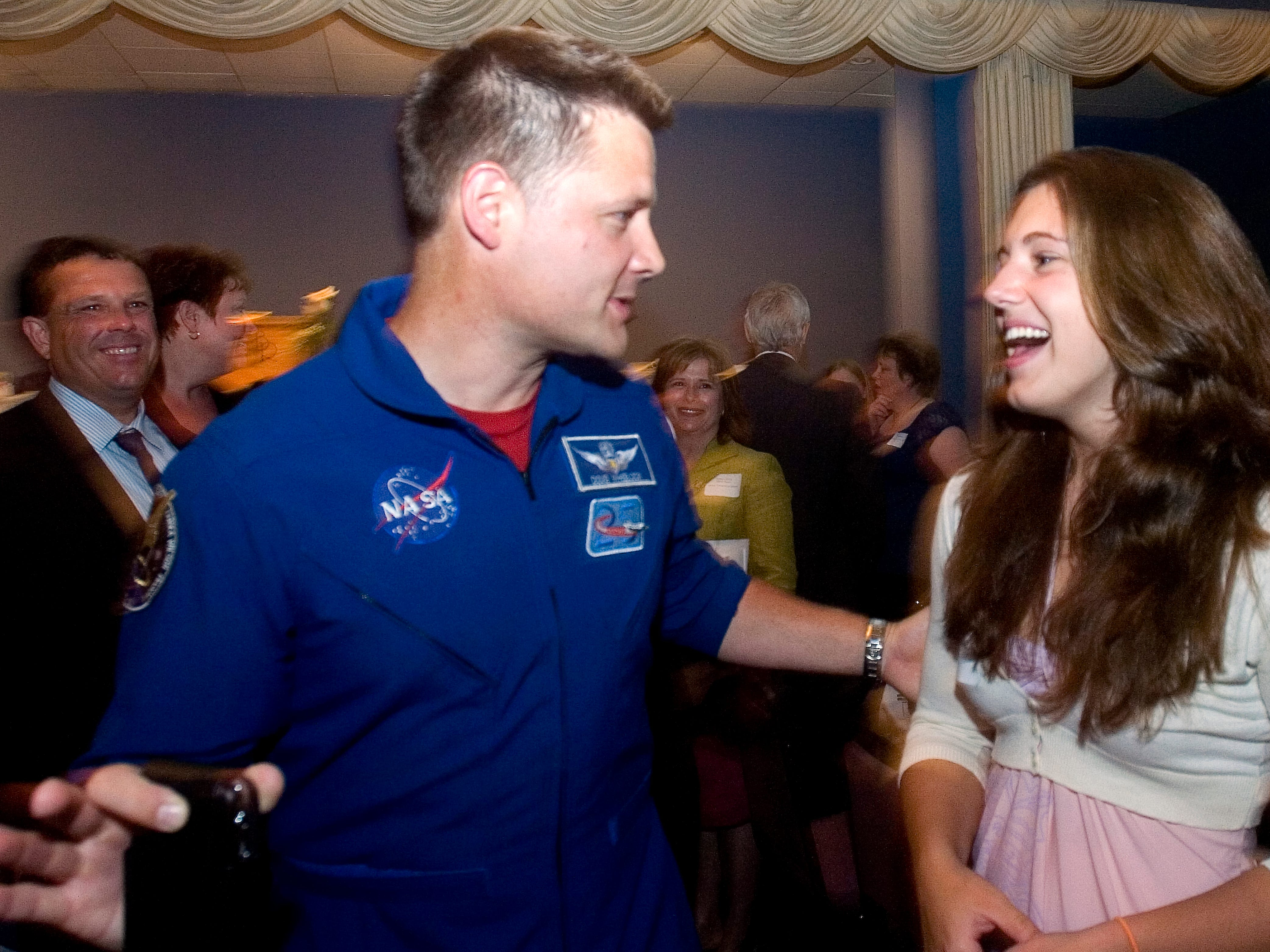 Windsor Salutatorian Kelsey Donaldson, right, chats with astronaut and Windsor alumnus Col. Douglas H. Wheelock during Wednesday's Scholastic Recognition Dinner at the Binghamton Regency.