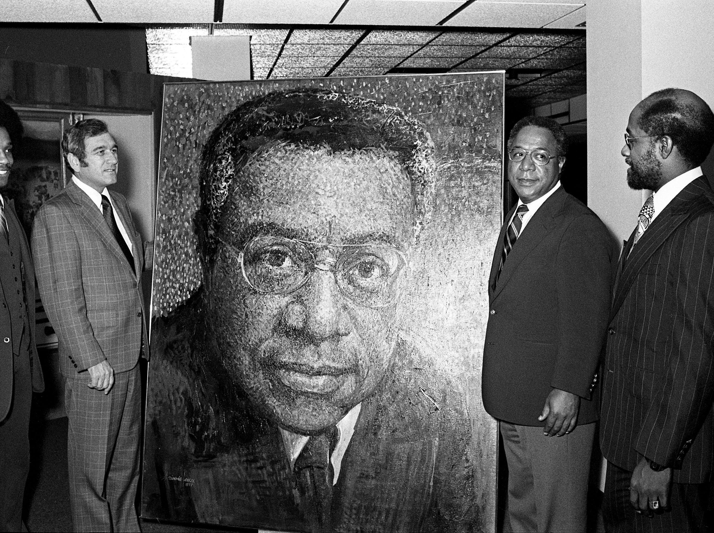 "State Rep. Dedrick Withers, D-Memphis, left, Gov. Ray Blanton, ""Roots"" author Alex Haley and artist Simmie L. Knox, stand in front of Knox's portrait of Haley that was unveiled in the State Museum during one of six activities held in Haley's honor during a ""Welcome Alex Haley Celebration"" in Nashville May 20, 1977."