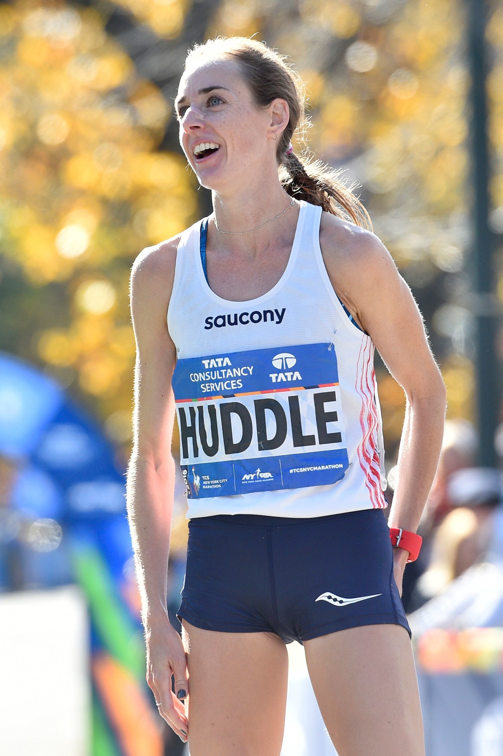 Molly Huddle reacts after crossing the finish line in third place at the New York City Marathon in 2016.