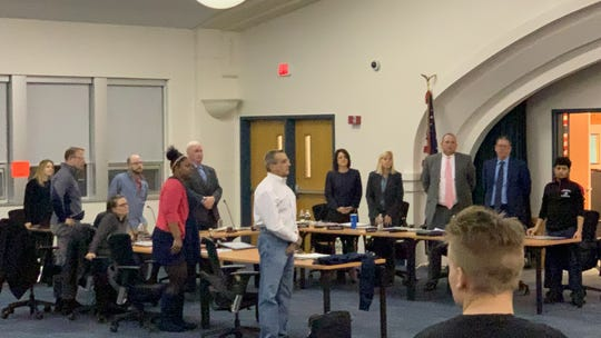 When asked to stand if people cared about the kids, members of the board stood. A community member told them, because of their inaction, to sit back down.