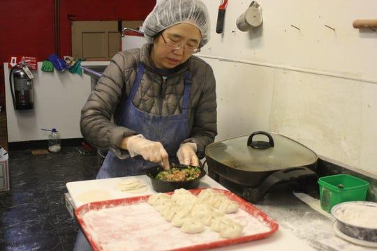 Zhengxuan Huang makes pork and chive dumplings at Beijing Dumpling in Binghamton on Jan. 16.