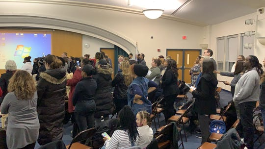 The crowd often erupted into standing applause to those addressing the board.