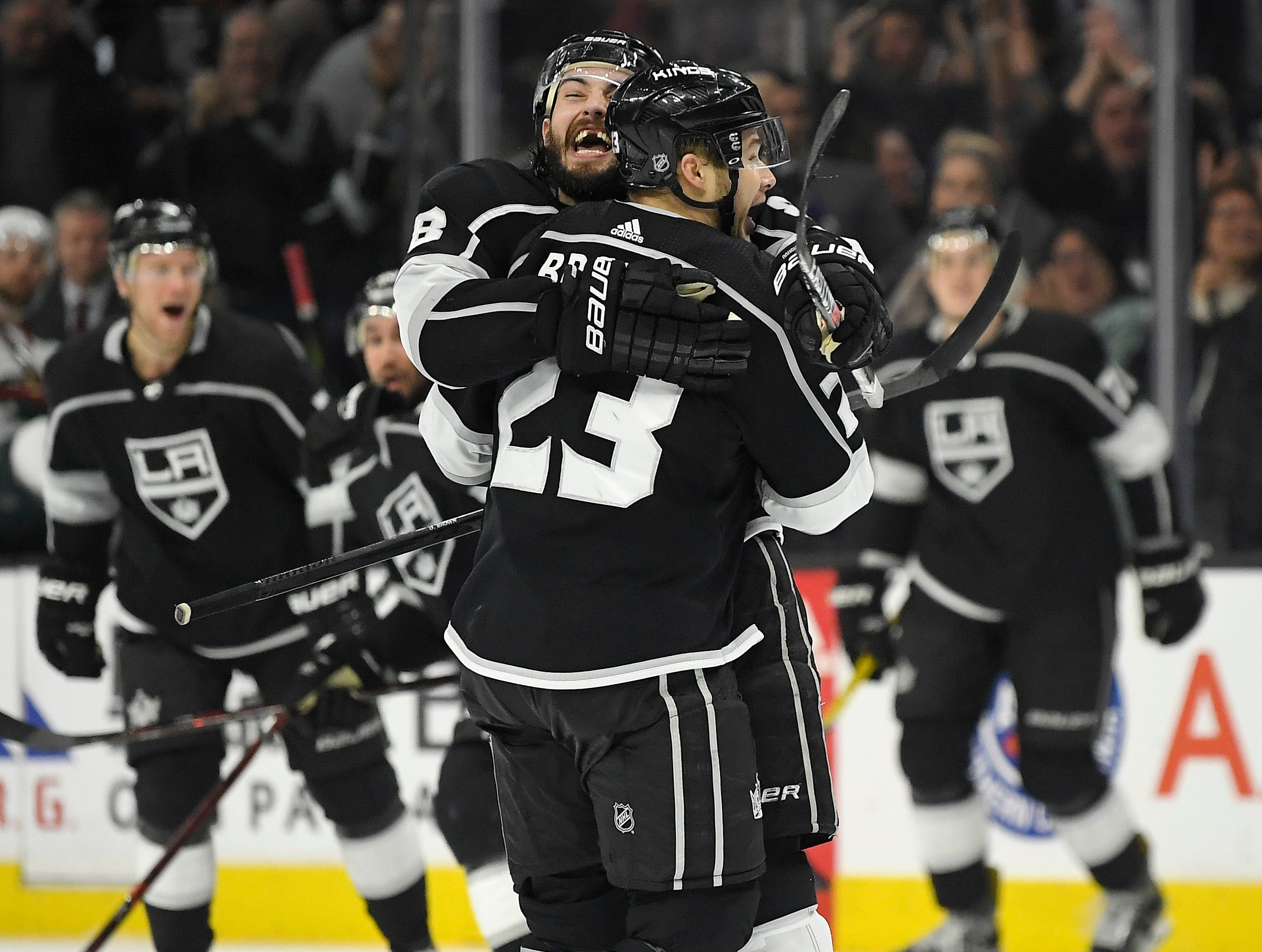 Los Angeles Kings right wing and Ithaca native Dustin Brown (23) celebrates his overtime goal with defenseman Drew Doughty in an NHL hockey game against the Minnesota Wild on Thursday, April 5, 2018, in Los Angeles. The Kings won 5-4.