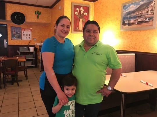 Mila Martinez, left, and Anibal Martinez with their son, 4-year-old Jeffrey Martinez, inside Grandma's Mexican Restaurant in Endicott.