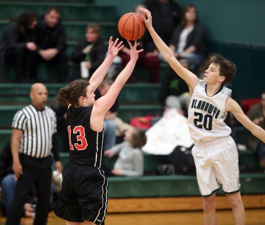 Klahowya's Drew Kraft blocks a shot during the Eagles' game against Chief Kitsap on Jan. 22. Klahowya's pressure defense has helped the team win 12 of its first 17 games this season.